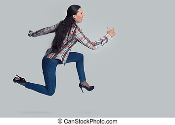 Full length portrait of woman running sideways Isolated over...