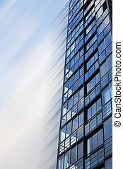 Blue building motion - Highrise glass building in motion