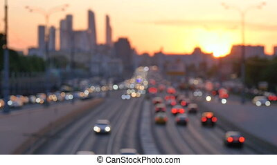 Car traffic at sunset. Bokeh background of the big city HD