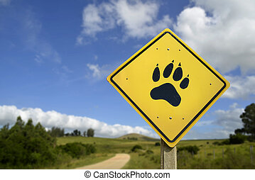 Wildlife animal concept with paw icon on road sign -...