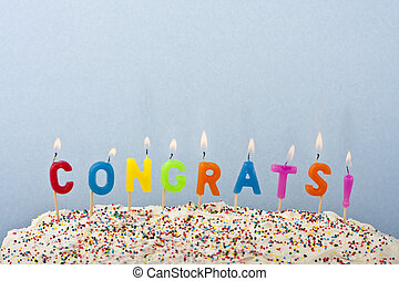congrats - a cake with white frosting and sprinkles...