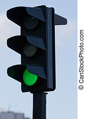 Traffic lights with green lit - Green light on black traffic...
