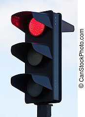 Traffic lights with red lit - red light on black traffic...