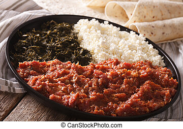 Ethiopian cuisine: kitfo with herbs and cheese and injera...