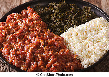 Ethiopian cuisine: kitfo with greens and cheese ayibe macro...