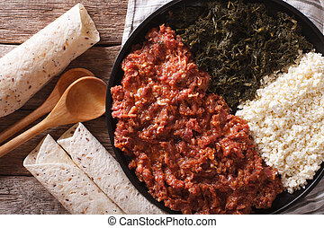 Ethiopian cuisine: kitfo with herbs and cheese. horizontal...