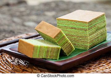 Traditional Indonesian sweet Lapis layer cake on a wooden background.
