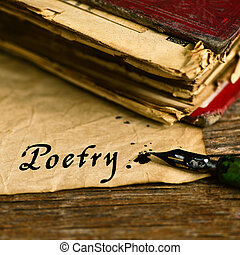text poetry written with a dip pen - closeup of an old book,...