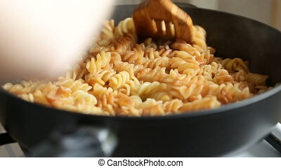 Dish with pasta mixed then add salt. Video full hd.