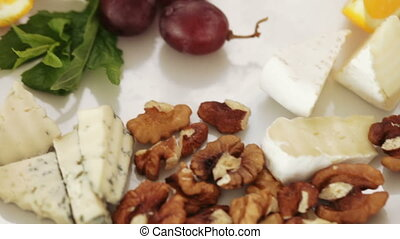 Cheese table at banquet - Cutting Cheese and nuts on plate