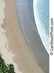 Ariel view on beach with wet sand and big wave