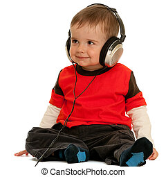 Smiling little boy with headphones