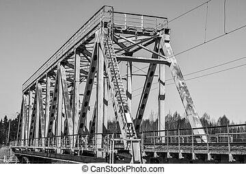 small railway bridge across the river, black and white photo