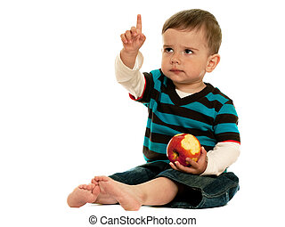 Children should eat apples - A serious toddler with a red...