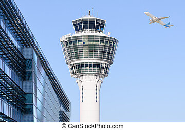 Munich international airport control tower and departing...