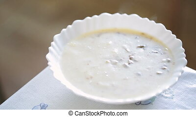 Hot mushroom soup in a white plate Video full hd