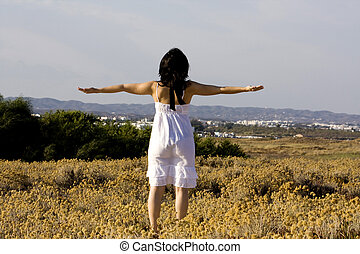 arms wide open - Young woman with white dress surrounded...