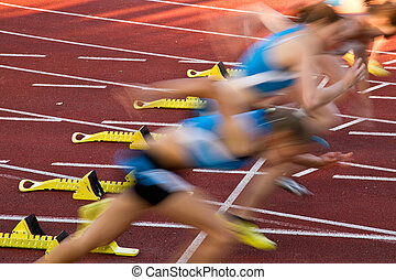 sprinters out of the starting block