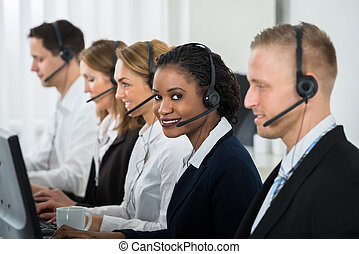 Businesswoman Working With Other Colleagues In Call Center -...