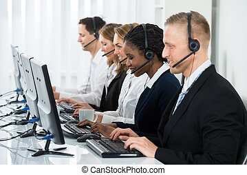 Businesspeople Working In Call Center - Team Of...