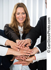 Businesspeople Putting Hands On Each Other - Group Of...