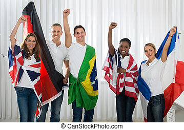 Friends With Flags From Different Nations - Group Of Happy...