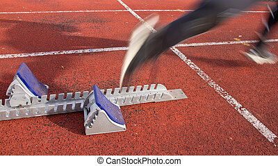 sprinting - sprinter out of the starting block