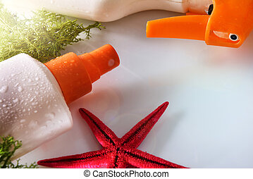 Two sunscreen spray with starfish elevated view close up -...