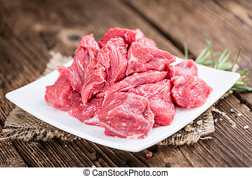 Beef Fillet (chopped) on wooden background - Beef Fillet...