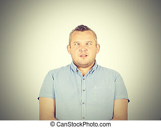 Cross-eyed man, funny faces isolated on background