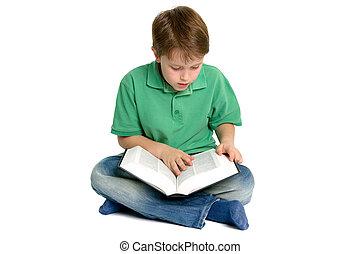 Boy reading crossed legs - Boy sat crossed legs reading a...