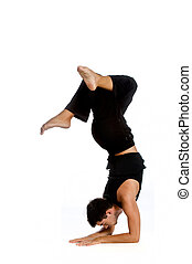 Athletic Man - An athletic man doing a handstand against...