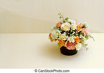 Artificial flowers on wood table - Artificial flowers in...