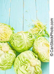 Green cabbage on wooden background
