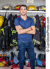 Confident Officer Standing At Fire Station - Portrait of...