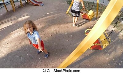 SLOW MOTION. Child runs on the playground . - SLOW MOTION....