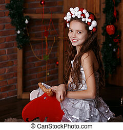 Portrait of a lovely little girl in hair band. Portrait of...