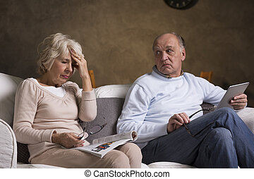 Health problems in older marriage - Older sad woman with...