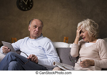 New technology and traditional newspaper - Older man using...
