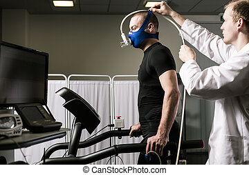 Checking the aerobic capacity - Doctor is setting up the...