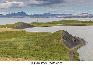 Myvatn Pseudo Craters - Lush green area at Lake Myvatn with...