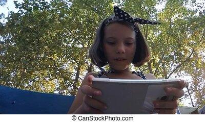 Baby girl playing smartphone