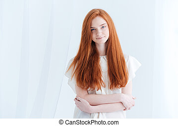 Woman looking at camera - Beautiful redhead woman looking at...