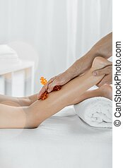 Body pamper and spa - Woman's leg isolated on a light...