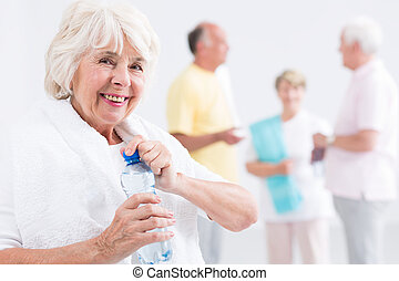 Needs to refresh herself after satisfying series of exercise