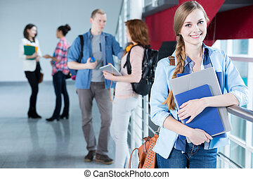 Female university student - Smiling female university...