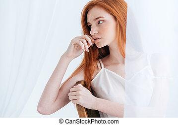 Thoughtful redhead woman looking away - Thoughtful redhead...