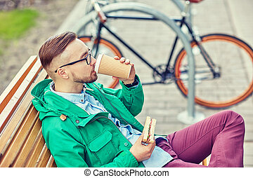 happy young hipster man with coffee and sandwich - people,...