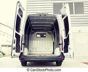 empty minivan car with open doors on city parking - freight...