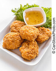 deep-fried shrimp cakes with sweet sauce on white background